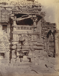 Close view of base of the Mala De Temple, showing details of sculpture on wall and porches, Gyaraspur, Bhopal State 10031314